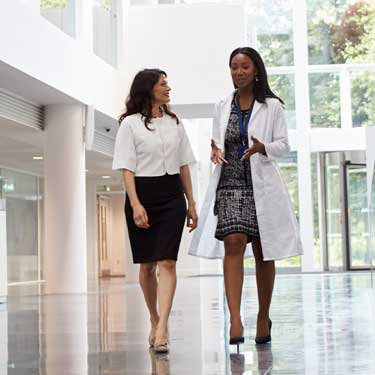 Two physicians walking and talking together