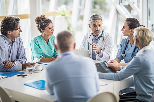 Physicians discussing around a table