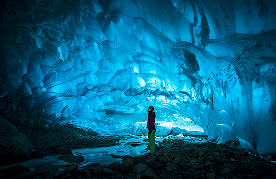 Looking inside blue ice cave in Canada