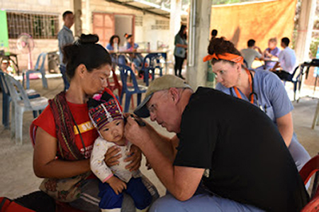 Doctor treating patient on a medical mission