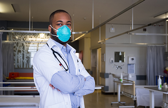 Physician wearing a mask