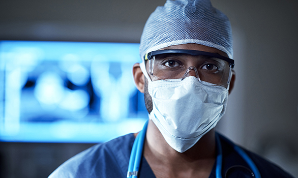 International locums physician wearing PPE