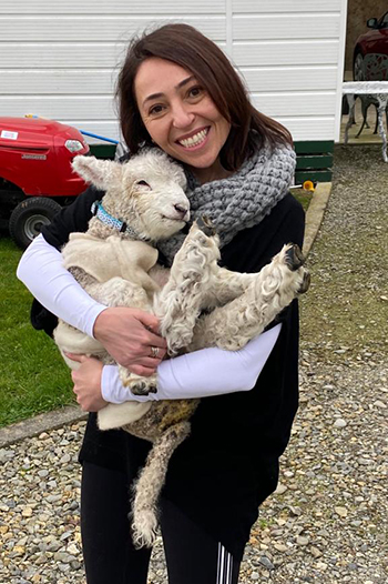 Dr. Restrepo holding a lamb